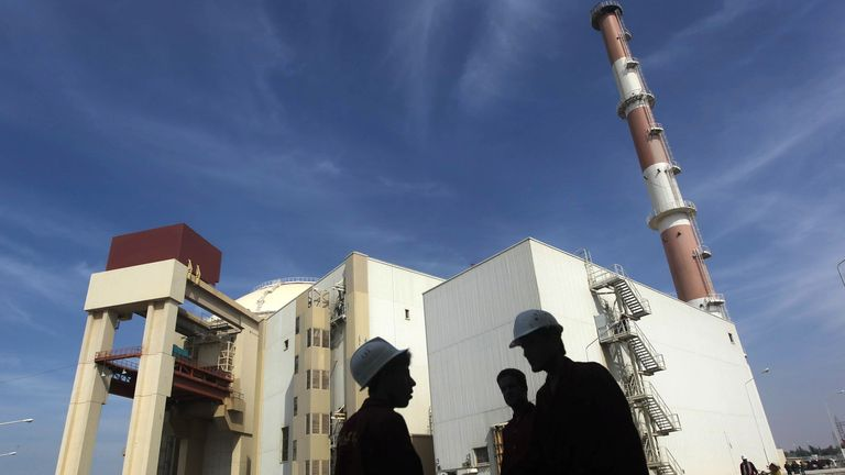 Workers in front of the Bushehr nuclear power plant in Iran