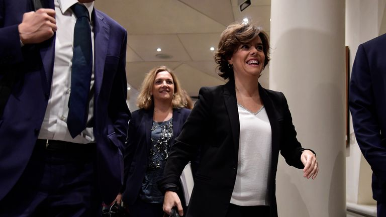 Soraya Saenz de Santamaria (R) arrives for a session of the Upper House of Parliament in Madrid