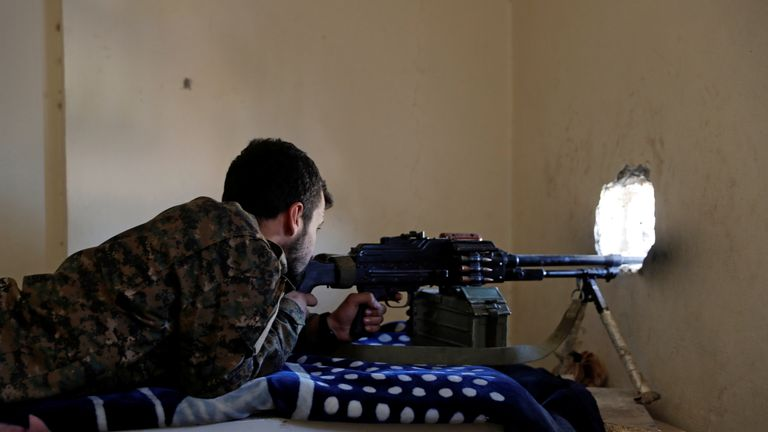 An SDF fighter taking aim at IS positions on Monday