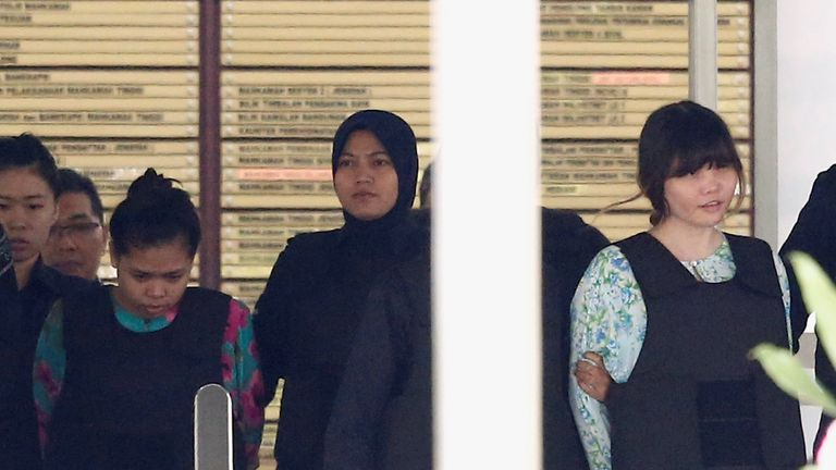 Siti Aisyah (L) and Doan Thi Huong outside court