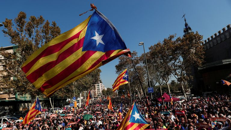 Demonstrators hold up Catalan separatist flags near the Catalan regional parliament in Barcelona