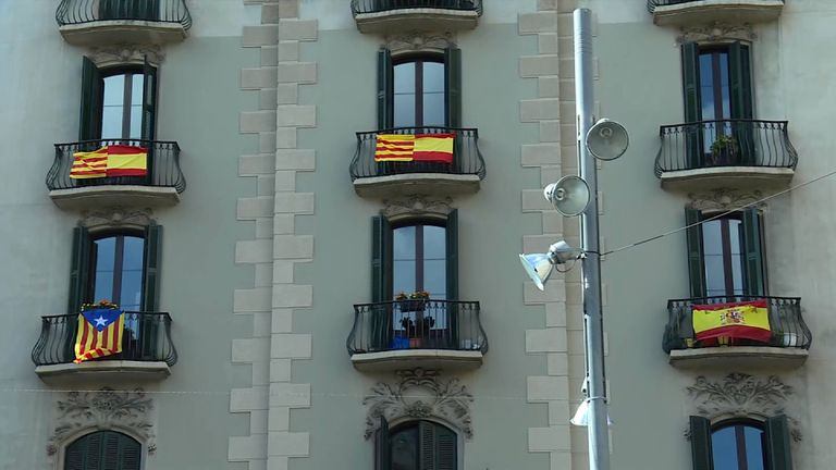 Spanish flags on balconies on of apartment building.