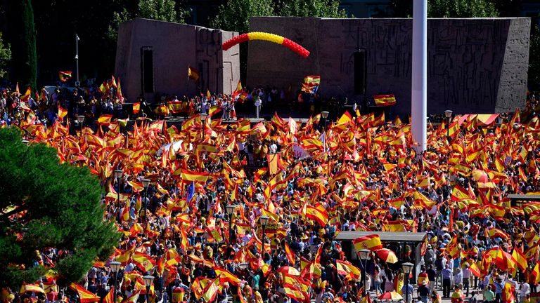 Protestors gather holding Spanish flags during a demonstration against independence of Catalonia called by DENAES foundation for the Spanish Nation Defence at Colon square in Madrid on October 07, 2017. Spain braced for more protests despite tentative signs that the sides may be seeking to defuse the crisis after Madrid offered a first apology to Catalans injured by police during their outlawed independence vote.