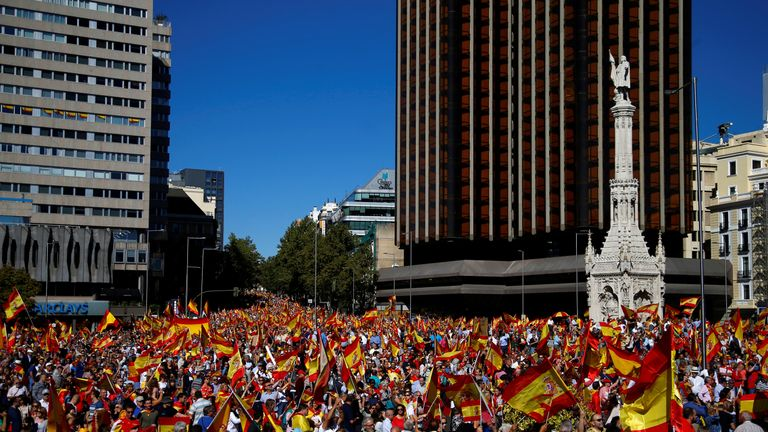 People wave Spain´s flag at a pro-union demonstration in Madrid