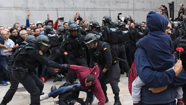 A man struggles with the police in Sany Julia de Ramis, near Girona