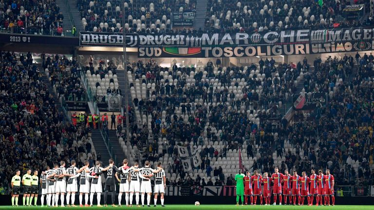 Juventus and SPAL players listen as a passage of Anne Frank's diary is read out