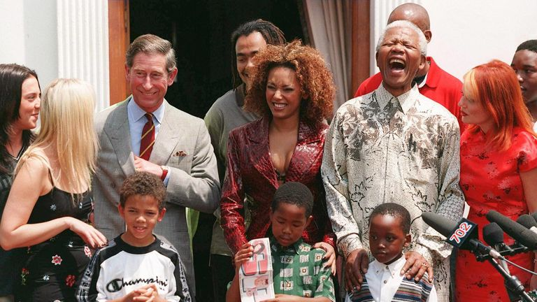 With Nelson mandela and Prince Charles in 1997
