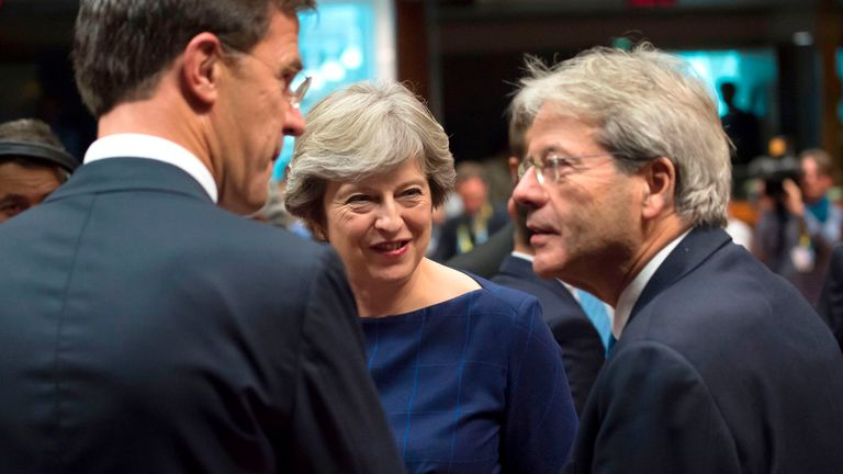 Britain's Prime minister Theresa May (C) talks with Dutch Prime minister Mark Rutte (L) and Italian Prime Minister Paolo Gentiloni in Brussels, on October 19, 2017 during the summit of European Union (EU) leaders, set to rule out moving to full Brexit trade talks after negotiations stalled. / AFP PHOTO / JOHN THYS (Photo credit should read JOHN THYS/AFP/Getty Images)