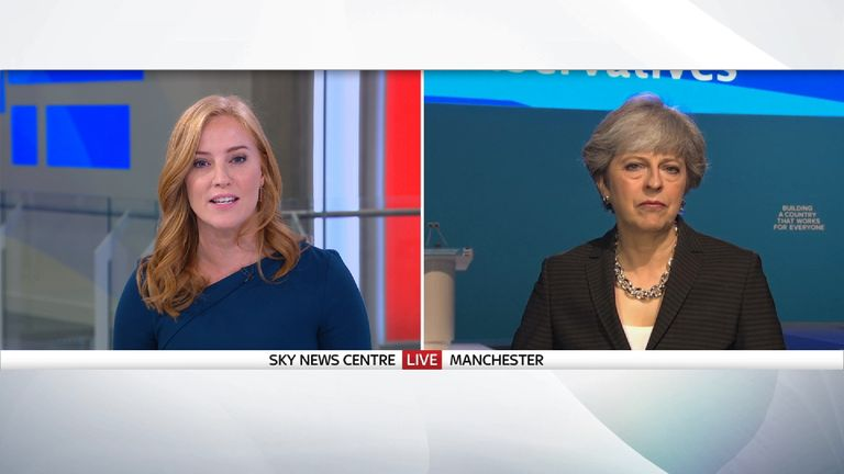 Theresa May says Boris Johnson will stick to the Tory script when he addresses the party conference.