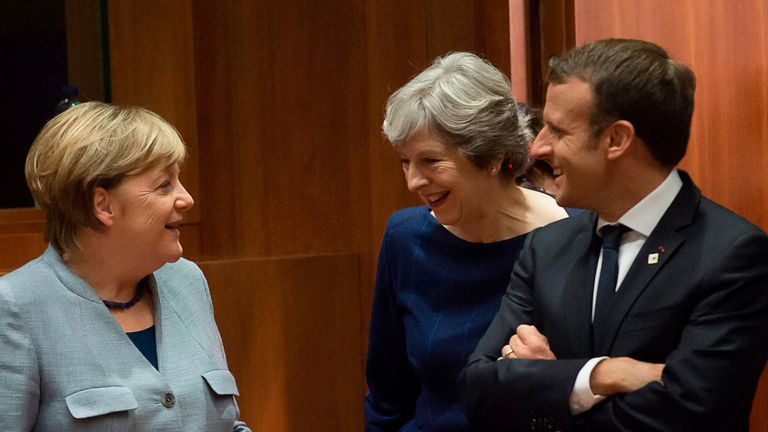(From L) German Chancellor Angela Merkel, Britain Prime minister Theresa May and French President Emmanuel Macron talk as they arrive in Brussels, on October 19, 2017 on the first day of a summit of European Union (EU) leaders, set to rule out moving to full Brexit trade talks after negotiations stalled. / AFP PHOTO / JOHN THYS (Photo credit should read JOHN THYS/AFP/Getty Images)