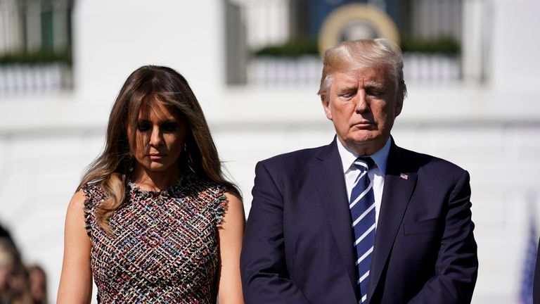 The President and First Lady hold a minute's silence for victims of the shooting