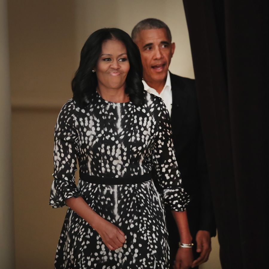 CHICAGO, IL - MAY 03: Former President Barack Obama and his wife Michelle arrive for a roundtable discussion at the South Shore Cultural Center about the Obama Presidential Center, which is scheduled to be built in nearby Jackson Park, on May 3, 2017 in Chicago, Illinois. The Presidential Center design envisions three buildings, a museum, library and forum. (Photo by Scott Olson/Getty Images)