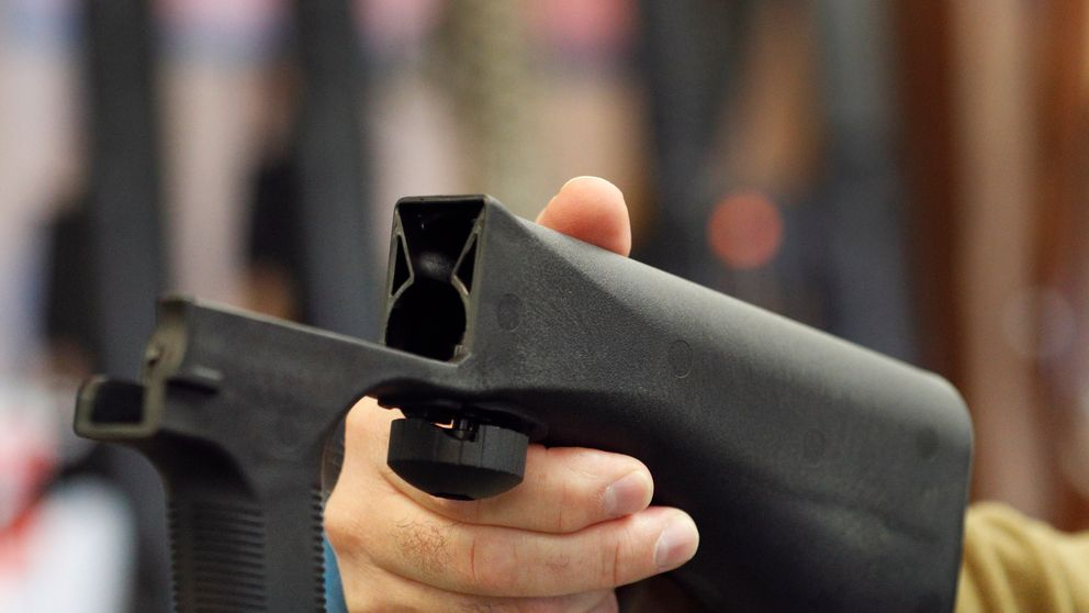 A bump stock device that fits on a semi-automatic rifle to increase the firing speed, making it similar to a fully automatic rifle, is shown here at a gun store on October 5, 2017 in Salt Lake City, Utah