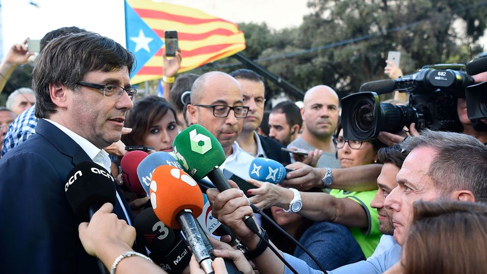 President of the Catalan Government Carles Puigdemont (L) answers to media after a pro-independence demonstration, on September 11, 2017 in Barcelona during the National Day of Catalonia
