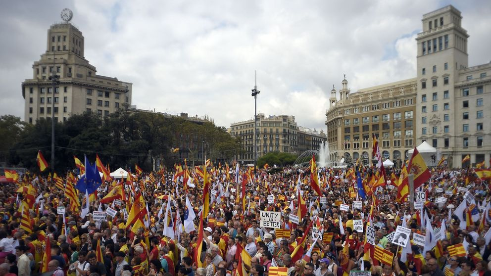 Protesters wave Spanish and Catalan flags in Barcelona