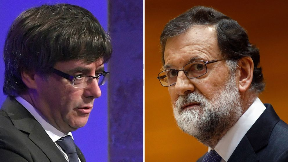 Spanish Prime Minister Mariano Rajoy and Catalan regional government leader Carles Puigdemont