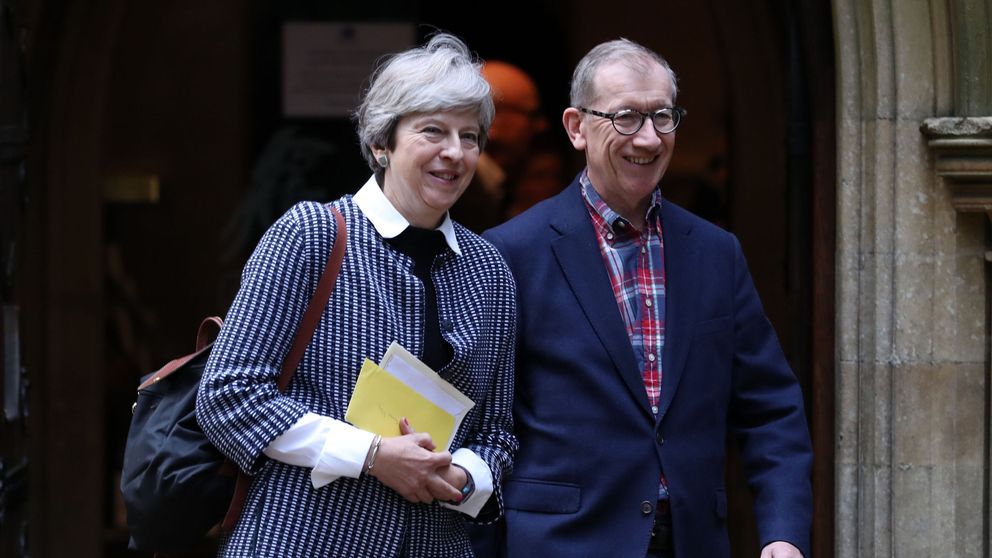 Theresa May and her husband Philip leave a service at St Andrew's Church in Sonning, Berkshire