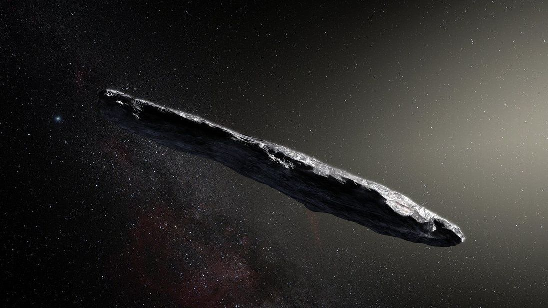 Undated European Southern Observatory handout image of an artistÕs impression showing the first interstellar asteroid: `Oumuamua. PRESS ASSOCIATION Photo. Issue date: Monday November 20, 2017. A lost interstellar asteroid has entered the solar system after wandering between the stars for hundreds of millions of years, scientists believe. The unique object, named Oumuamua, is highly elongated, about 400 metres (1,312 ft) long and coloured dark red. It is the first space rock from outside the sola