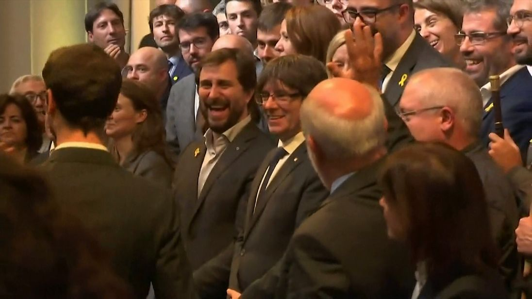 Mr Puigdemont described Madrid's actions as a 'coup'