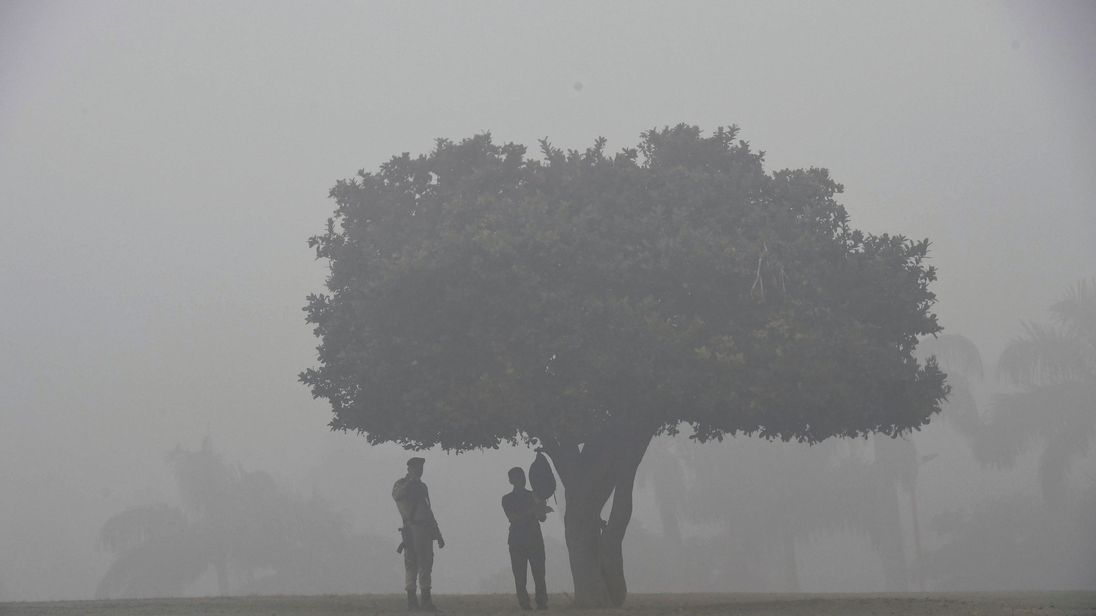 Indian security personnel stand guard at the Rajghat memorial amid heavy smog in New Delhi