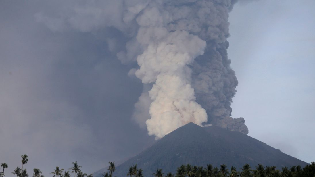 A view of Mount Agung volcano erupting from Culik village in Karangasem