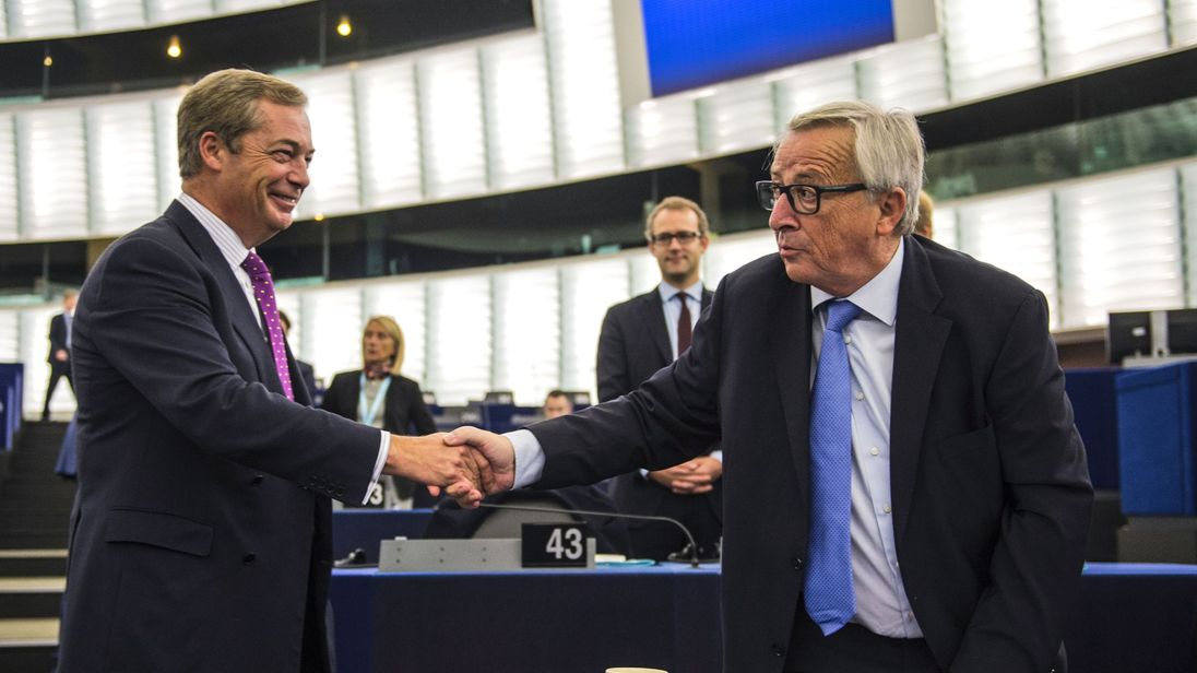 Nigel Farage shakes hands with European Commission President Jean-Claude Juncker