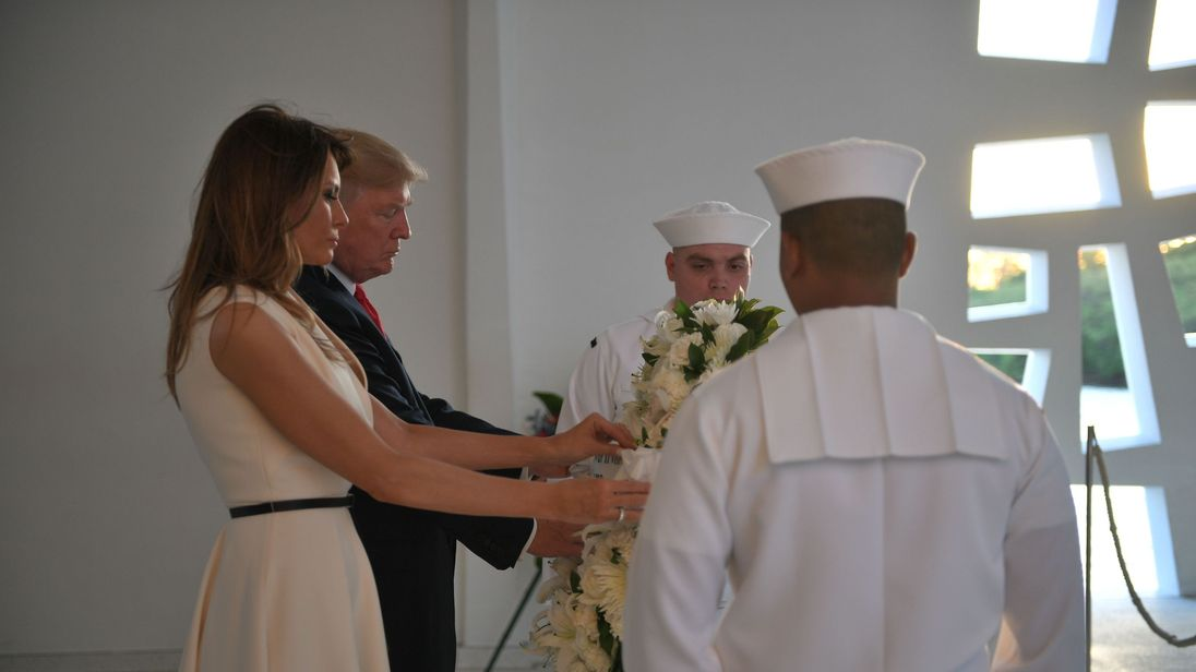 US President Donald Trump and First Lady Melania Trump lay a wreath at the USS Arizona Memorial on November 3, 2017, at Pearl Harbor in Honolulu, Hawaii