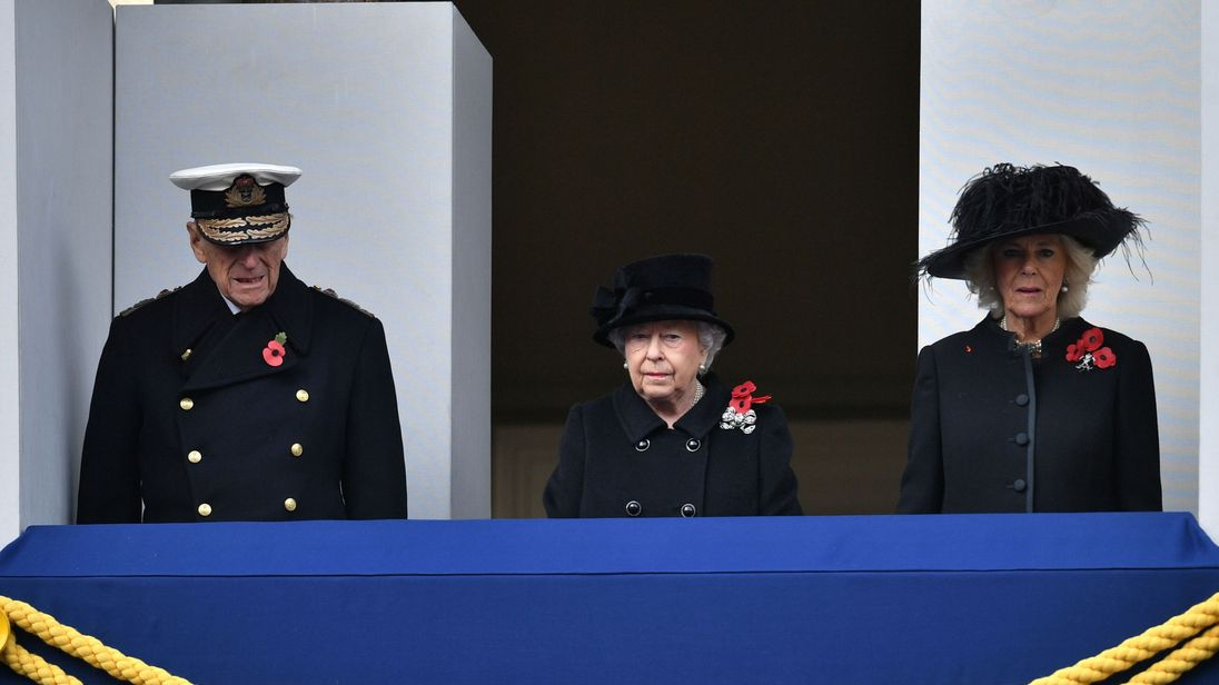 The Queen, Prince Philip and the Duchess of Cornwall watch from a Foreign Office balcony