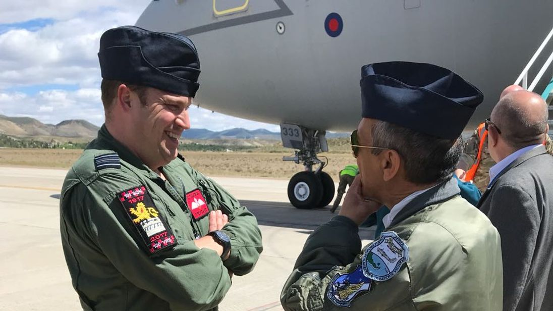 RAF servicemen are greeted by the base commander. Pics: Guillermo Lobo