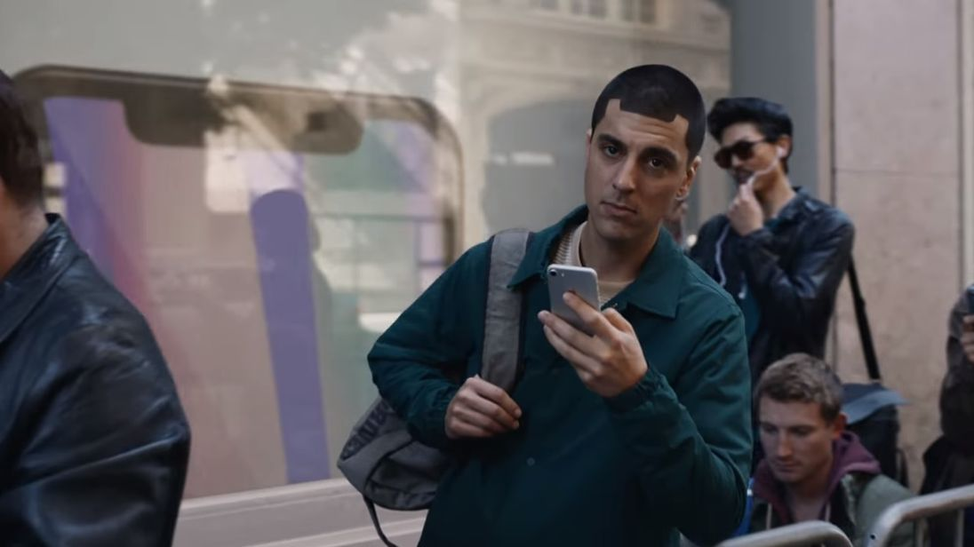 A man's hairline resembles the iPhone X's 'notch'. Pic: Samsung