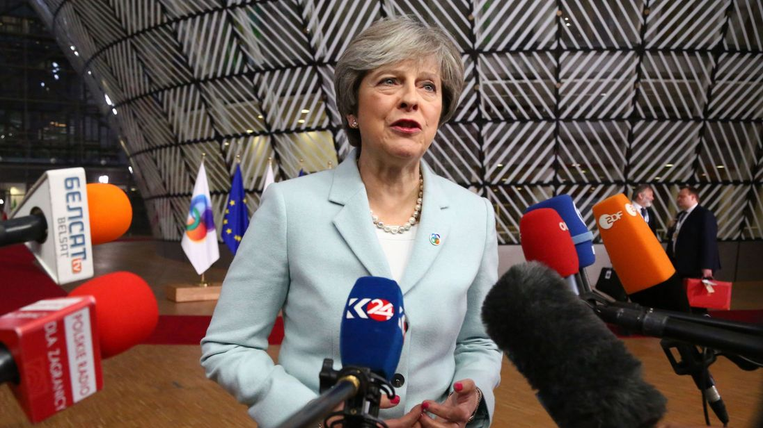 British Prime Minister Theresa May speaks to journalists as she arrives for an ?EU Eastern Partnership summit with six eastern partner countries at the European Council in Brussels on November 24, 2017
