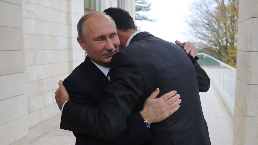 Russia's President Vladimir Putin embraces his Syrian counterpart Bashar al-Assad during a meeting in Sochi
