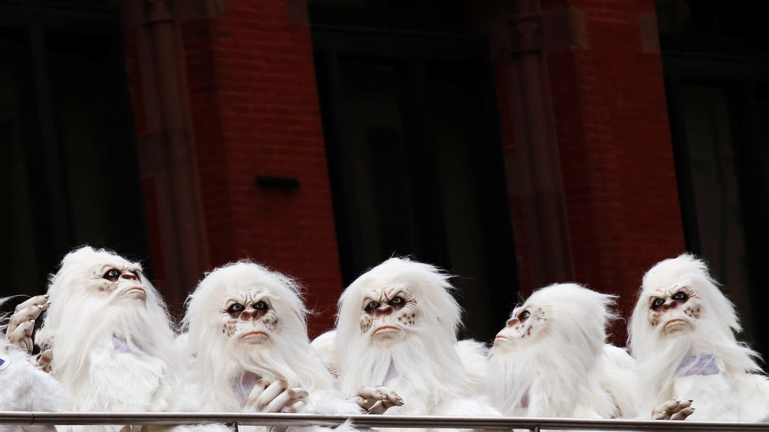 "Actors dressed as a 'Yeti' ride aboard a tour bus during a promotional event for Travel Channel's ""Expedition Unknown: Hunt for the Yeti"" in Manhattan, New York City"
