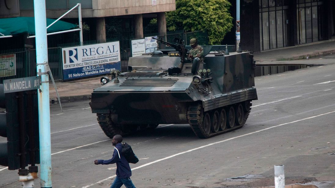 Zimbabwean soldiers stand at a junction as they control traffic in Harare