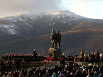 Serving servicemen and veterans attend a Remembrance Sunday Service at the Commando Memorial at Spean Bridge