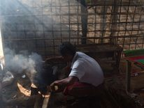 A Rohingya refugee cooks in a restaurant at the Thankhali refugee camp