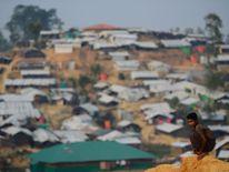 A Rohingya refugee boy looks on at Balukhali refugee camp