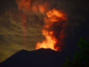 A general view shows Mount Agung erupting seen at night from Kubu sub-district in Karangasem Regency on Indonesia's resort island of Bali on November 28, 2017