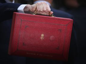 LONDON, ENGLAND - MARCH 16: British Chancellor of the Exchequer, George Osborne carries the Budget Box outside 11 Downing Street on March 16, 2016 in London, England. Today's budget will set the expenditure of the public sector for the year beginning on April 1st 2016 against the revenues gathered by HM Treasury. (Photo by Dan Kitwood/Getty Images)