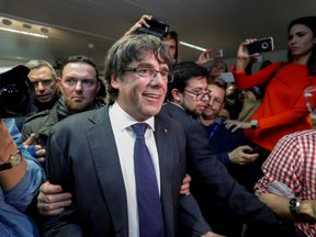 Mr Puigdemont said he and his former ministers in Belgium represent a 'government in exile'