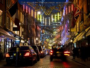 Christmas lights are displayed near Covent Garden in central London on December 18, 2013