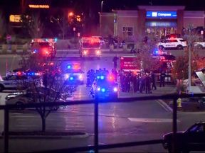 Customers and staff ran out of the Walmart store in Thornton after the gunman opened fire