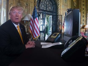 US President Donald Trump prepares his traditional address to thank members of the US military via video teleconference on Thanksgiving day, November 23, 2017 from his residence in Mar-a-Lago in Florida