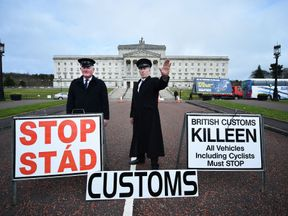 BELFAST, NORTHERN IRELAND - MARCH 29: Two men dressed as customs officers take part in a protest outside Stormont against Brexit and it's possible effect on the north and south Irish border on March 29, 2017 in Belfast, Northern Ireland. British Prime Minister Theresa May will address the Houses of Parliament later today as Article 50 is triggered and the process that will take Britain out of the European Union will begin. (Photo by Charles McQuillan/Getty Images)