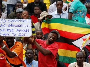 People wait for the inauguration ceremony of Zimbabwe's next president Emmerson Mnangagwa