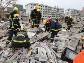 Rescue workers look for survivors after an explosion in Ningbo, China's eastern Zhejiang province on November 26, 2017
