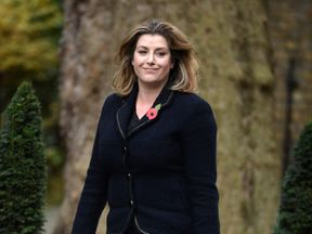Penny Mordaunt walks up Downing Street