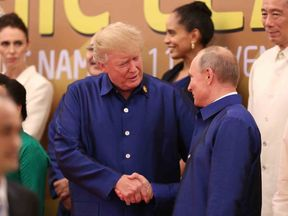 Donald Trump and Vladimir Putin at the APEC summit