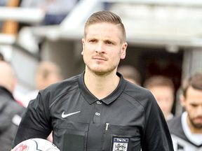 Ryan Atkin is an openly gay football referee supporting Rainbow Laces campaign