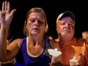 Residents take part in a vigil for victims of a mass shooting in Sutherland Springs